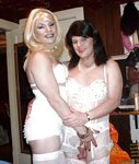Lisa and I in our bridal lingerie. Picture taken by our husband, Jack. Poly...