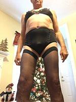 Black thigh highs, panties and bra. I love it.